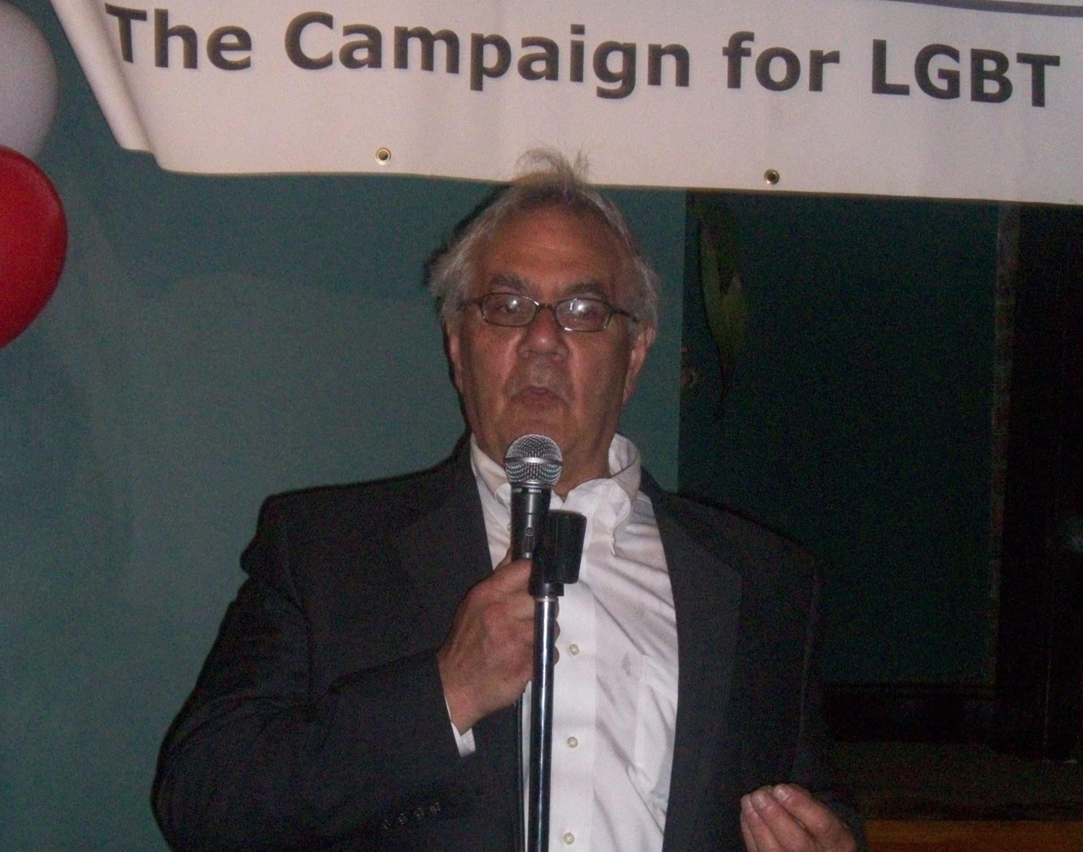 Rep Barney Frank speaks in front of MassEquality banner.