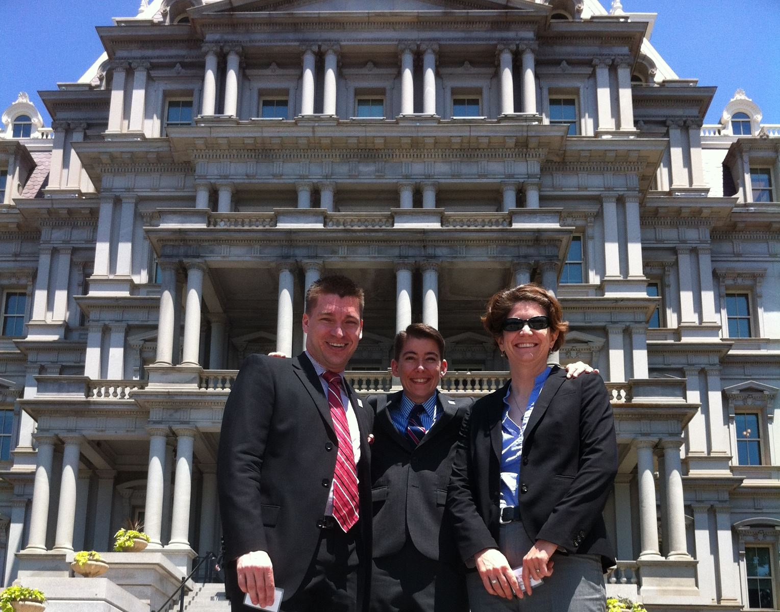 MassEquality staff in front of Eisenhower Executive Office Building in DC