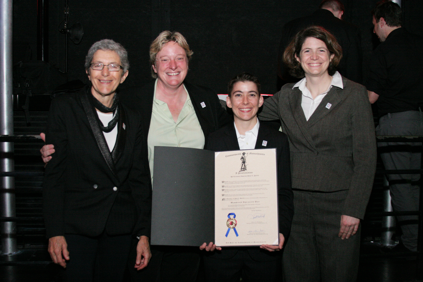 """MassEquality staff pose with official proclamation of """"Marriage Equality Day."""""""